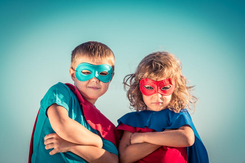 Superhero kids. Superhero children against summer sky background. Kids having fun outdoors. Boy and girl playing. Success and winner concept royalty free stock image