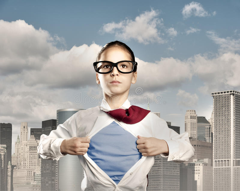 Superhero little girl stock photo