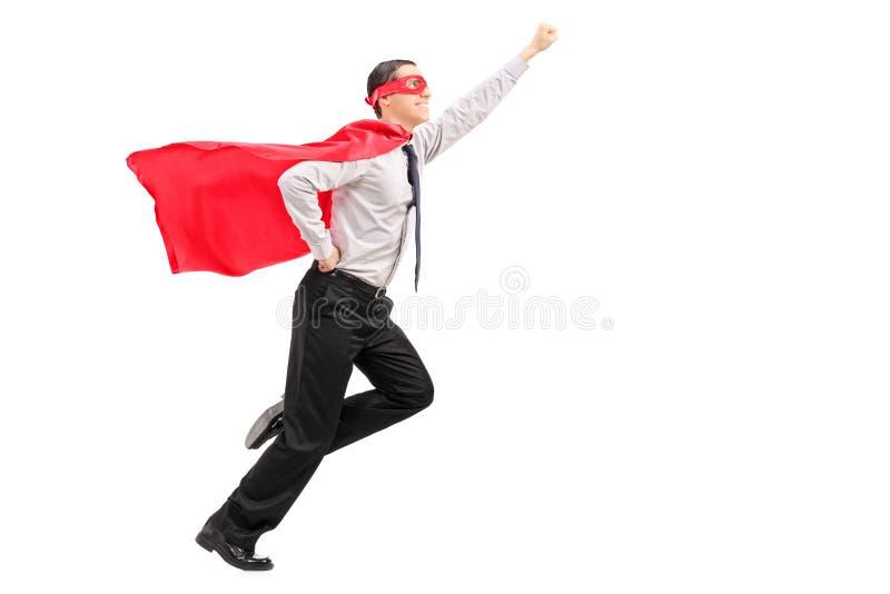 Superhero som lanserar in i luften arkivfoton