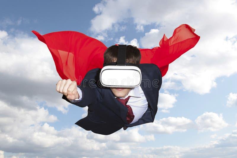 Superhero wearing virtual reality glasses flying royalty free stock images