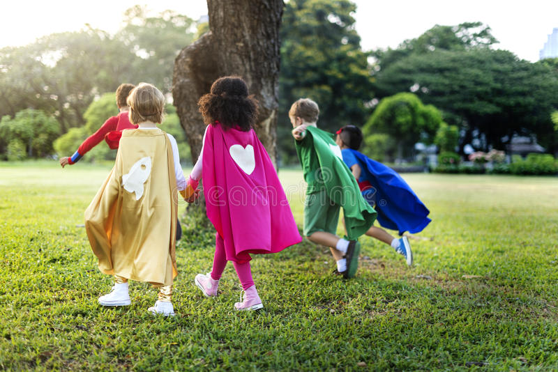 Superheroes Cheerful Kids Expressing Positivity Concept. Superheroes Cheerful Kids Expressing Positivity stock photography