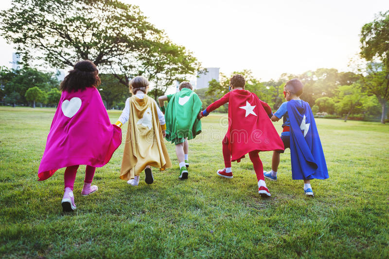 Superheroes Cheerful Kids Expressing Positivity royalty free stock photography