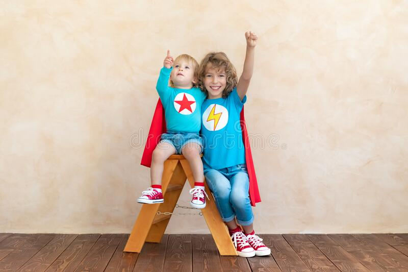 Superheroes children playing at home royalty free stock image