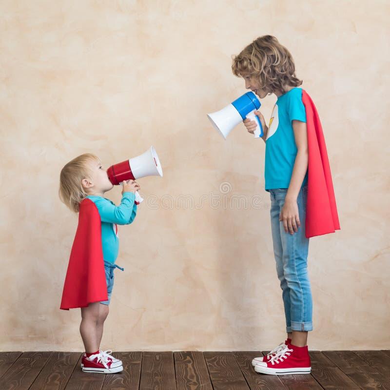 Free Superheroes Children Speaking By Loudspeaker Stock Photo - 181635580