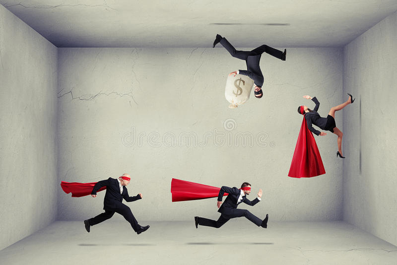 Superheroes trying to catch criminals stock images