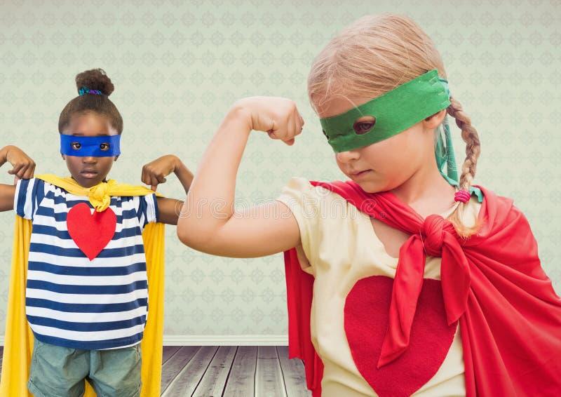 Superheroflickaungar med tom rumbakgrund royaltyfri bild