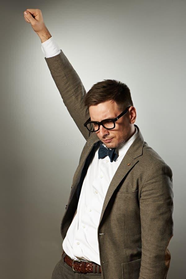 Superheronerd i glasögon och fluga royaltyfri foto