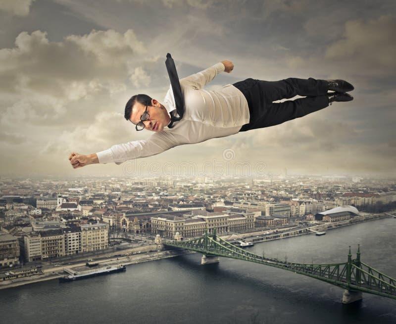 Superhombre del vuelo foto de archivo libre de regalías