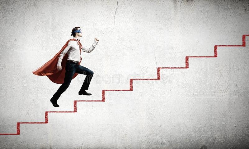 Superhombre en escalera imagen de archivo libre de regalías