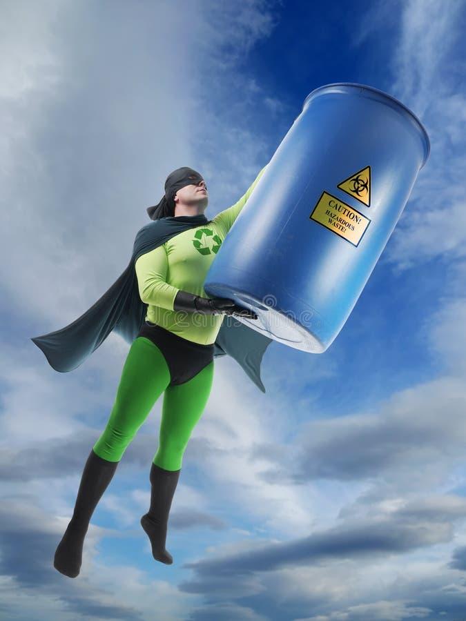 Superman et déchets dangereux d'Eco photographie stock