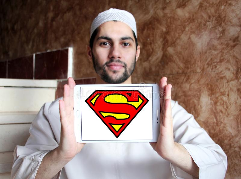 Superman logo. Logo of Superman on samsung tablet holded by arab muslim man. Superman is a fictional superhero appearing in American comic books published by DC stock photography