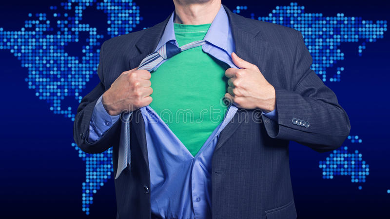 Superman saves the world. Superman on a background map of the world rips his shirt royalty free stock images