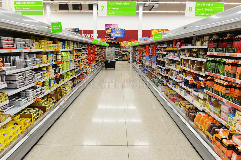 Supermarket Aisle View. Aisle view of an Asda supermarket on August 18, 2014 in London, UK. Founded in 1949 Asda is the UK's third largest retail chain with 568 stock image