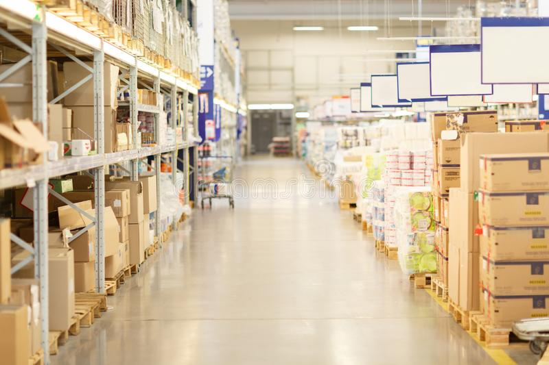 Supermarket aisles and shelves on blurred background. royalty free stock photo