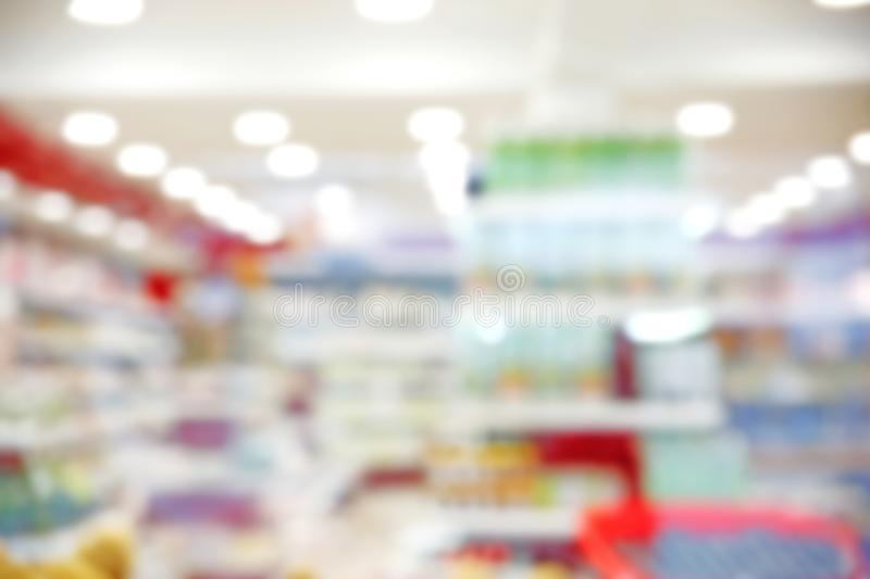 Supermarket blurred background.Shop defocused rows stock photography