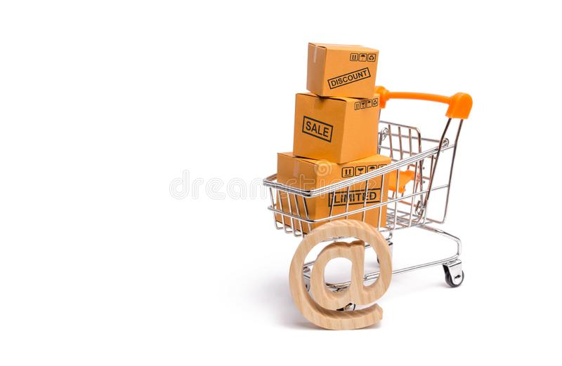 Supermarket cart with boxes, merchandise: the concept of buying and selling goods and services, internet commerce, online shopping royalty free stock photography