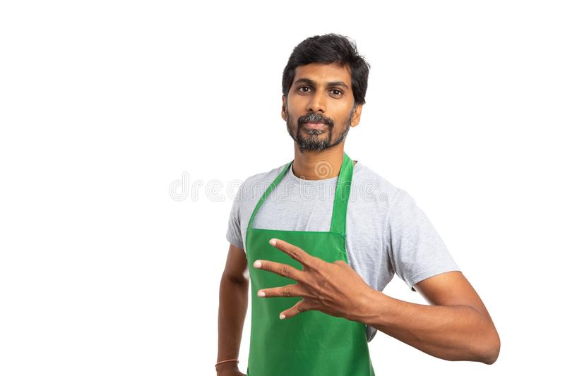 Supermarket employee showing number four gesture royalty free stock image
