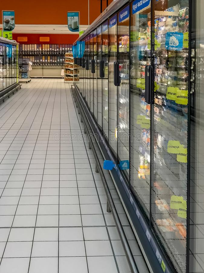 Supermarket freezer. Row of freezers at the supermarket stock photography