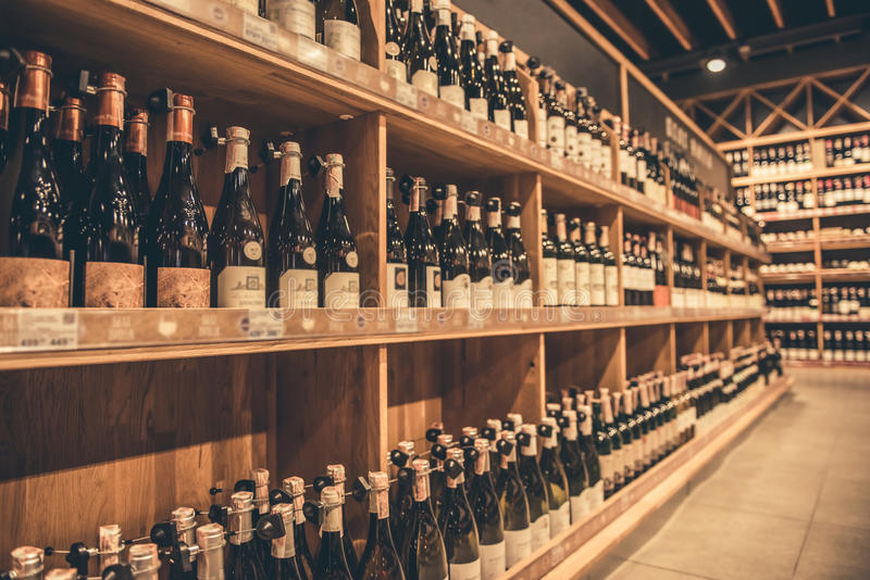 At the supermarket. Rows of wine waiting for customers stock photos