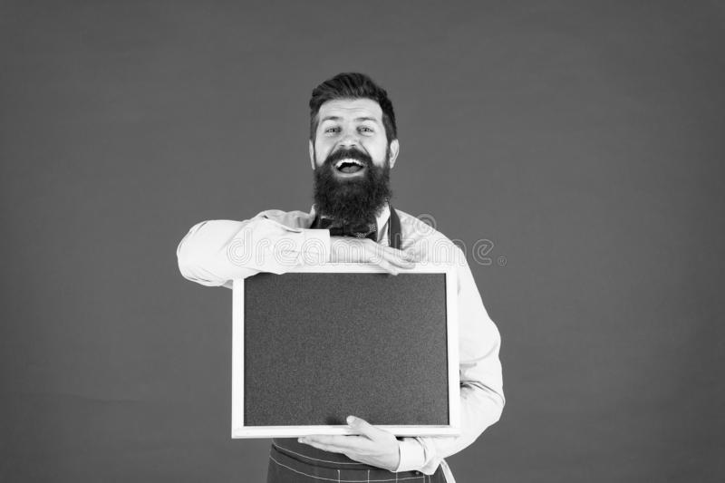 Supermarket sales. menu board. happy man chef with blank blackboard, copy space. great cuisine. cooking by recipe. Welcome. Restaurant or cafe advertising stock photography