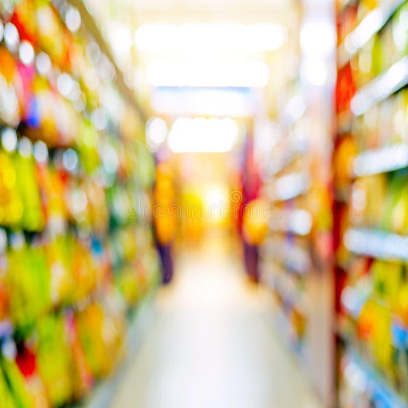 Supermarket shelves. And merchandise, Gaussian blur effect stock photos