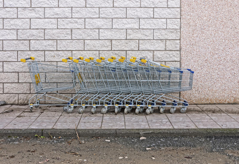 Download Supermarket Shopping Trolleys By Wall Royalty Free Stock Images - Image: 21954989