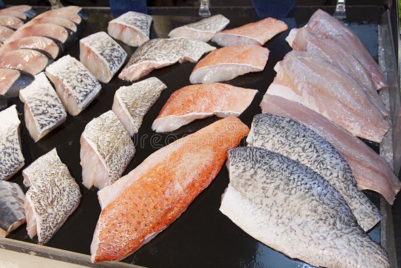 Supermarket stall with raw fish. Supermarket stall with Salomon and Coalfish Pollachius virens raw fish - fresh fish counter full with diverse - organic fish stock photo
