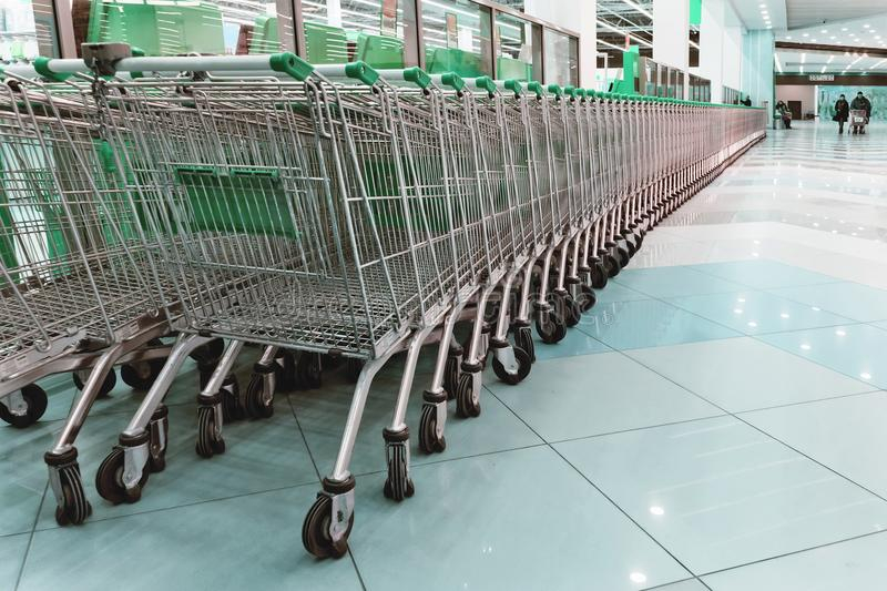 Supermarket Trolley Shopping Consumer Retail Business concept. Inside a large supermarket. Modern and stylish shopping Mall. Grocery store royalty free stock photography