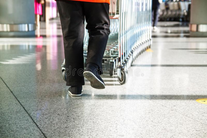 Supermarket Trolley Shopping Consumer Retail Business concept. Man carries trolleys royalty free stock images