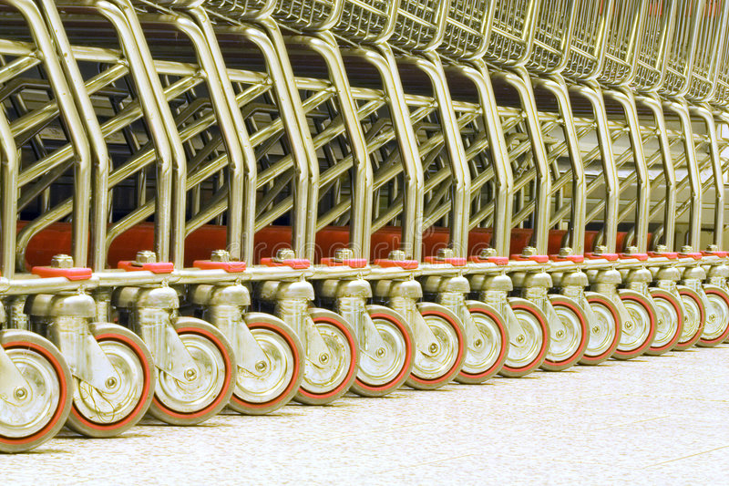 Supermarket trolleys. Trolleys for purchases at supermarket stock photo