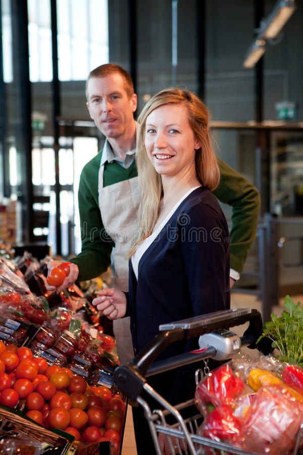 Supermarket Woman and Clerk stock photo