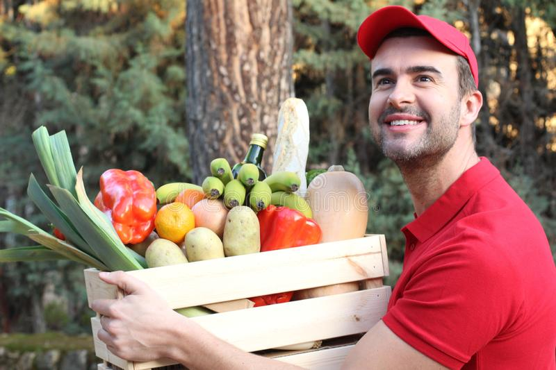 Supermarket worker delivering healthy food royalty free stock photography