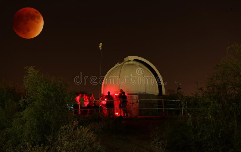 2015 Supermoon Eclipse at the Gilbert Rotary Centennial Observatory. People at Riparian Preserve in Arizona, watching the 2015 Supermoon eclipse at the Gilbert royalty free stock image
