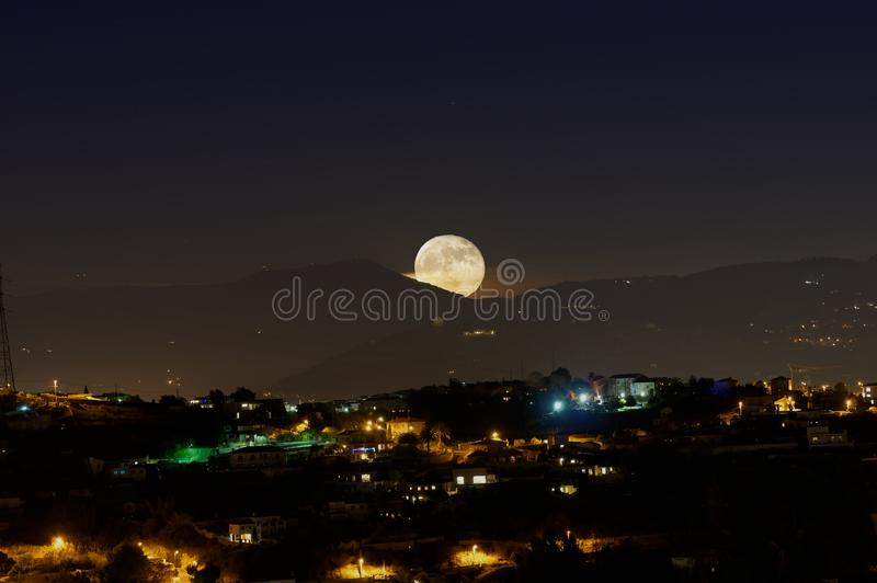 Supermoon at moonrise royalty free stock photography