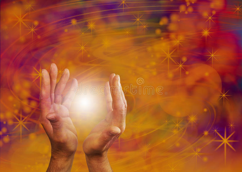 Supernatural Orb Energy. Male hands reaching up around a white orb light on a ethereal orange and purple flowing energy formation background with plenty of copy royalty free stock photos