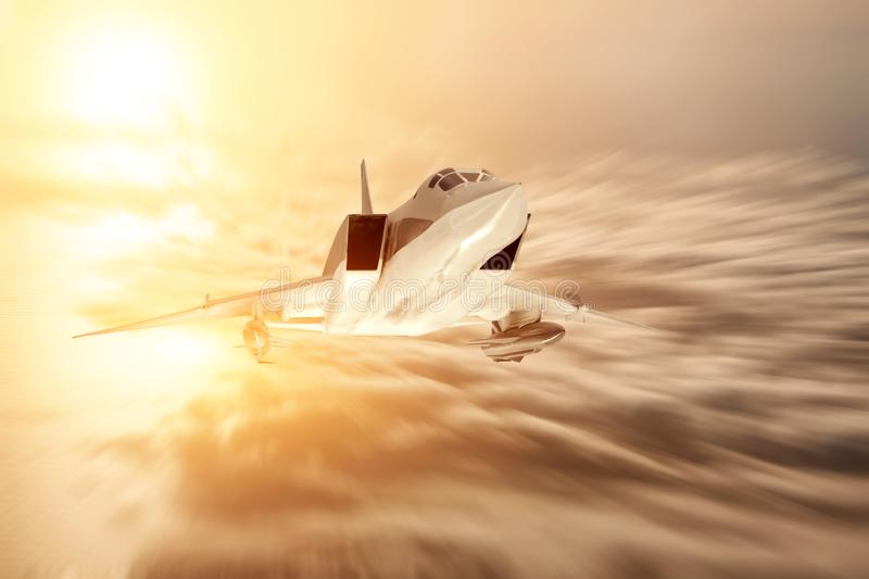 Supersonic bomber flies at high speeds above the clouds and the sea stock photo