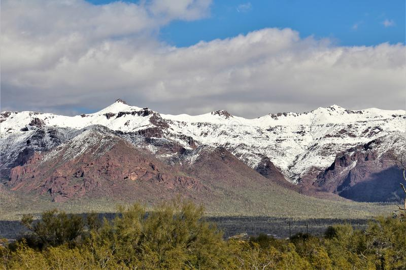 Superstition Mountains Arizona, Tonto National Forest, Apache Junction, Arizona, United States. Rare scenic snow landscape view of the Superstition Mountains in royalty free stock images