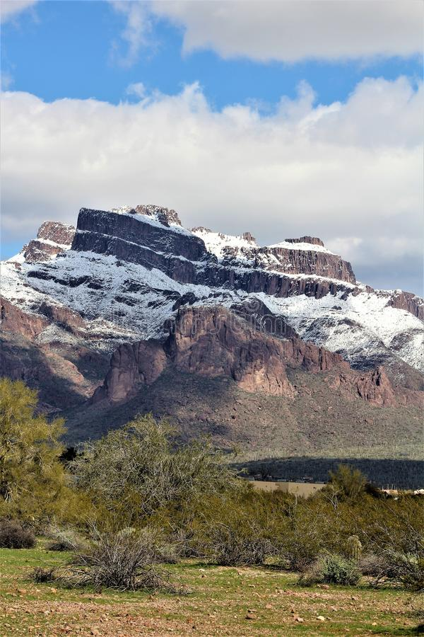 Superstition Mountains Arizona, Tonto National Forest, Apache Junction, Arizona, United States. Rare scenic snow landscape view of the Superstition Mountains in stock photos