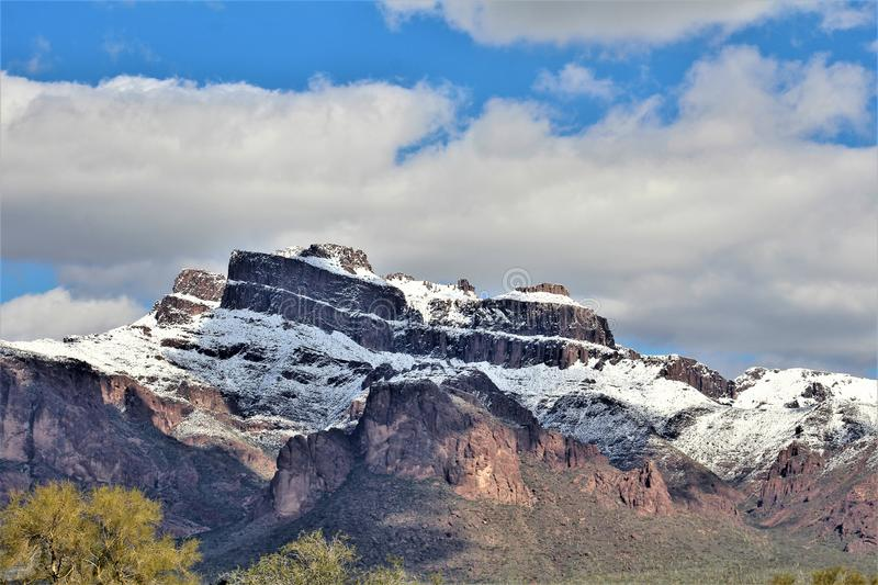 Superstition Mountains Arizona, Tonto National Forest, Apache Junction, Arizona, United States. Rare scenic snow landscape view of the Superstition Mountains in stock photo