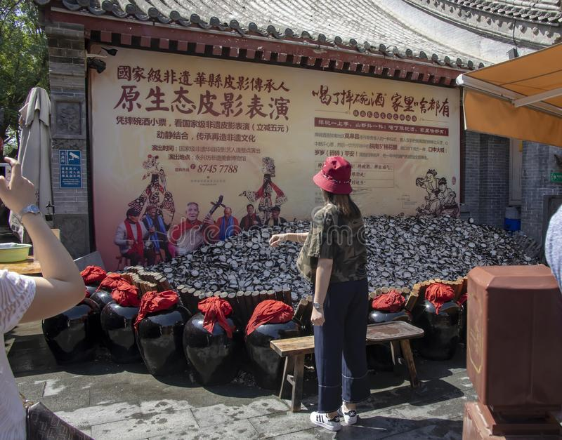 Superstitious tourists smashing cups at Yongxingfang Intangible stock photo