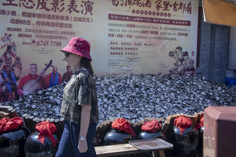 Superstitious tourists smashing cups at Yongxingfang Intangible stock image