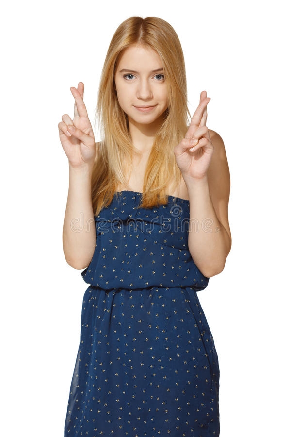 Superstitious young female with crossed fingers stock photo