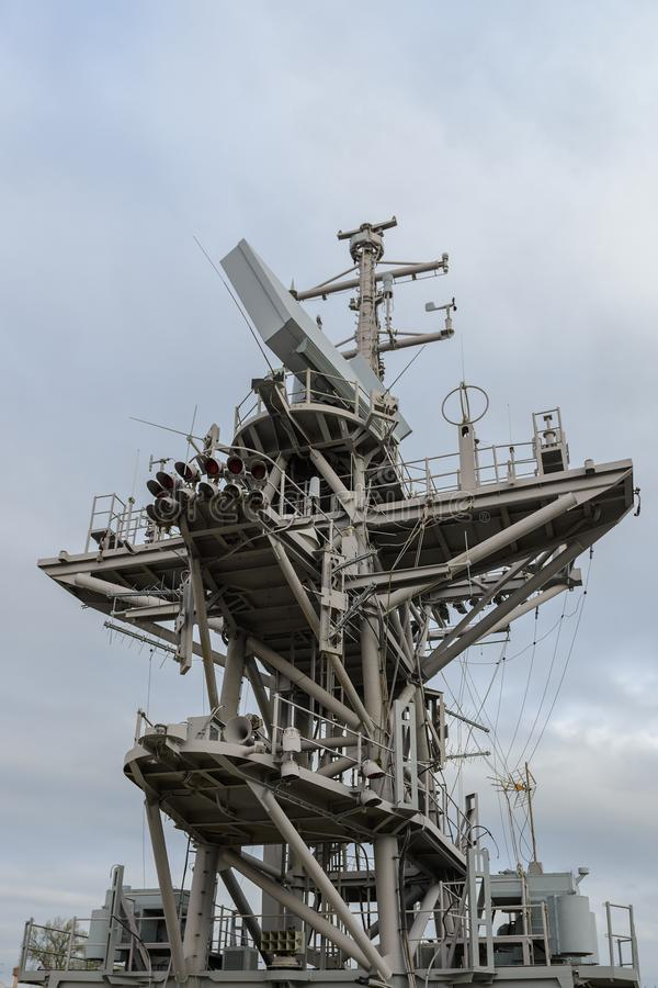 Superstructure of a warship against a blue sky stock image