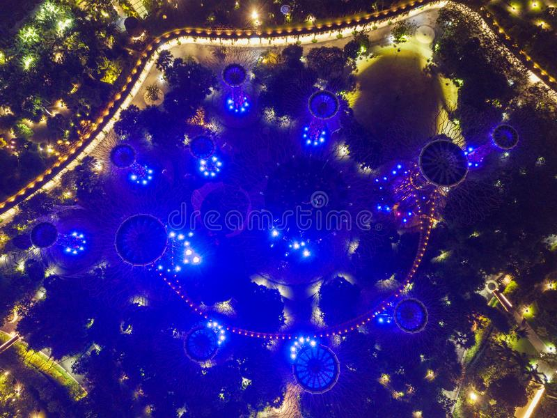 Supertree Grove. Garden by the bay in Marina Bay area in Singapore City. Aerial view at night.  stock illustration