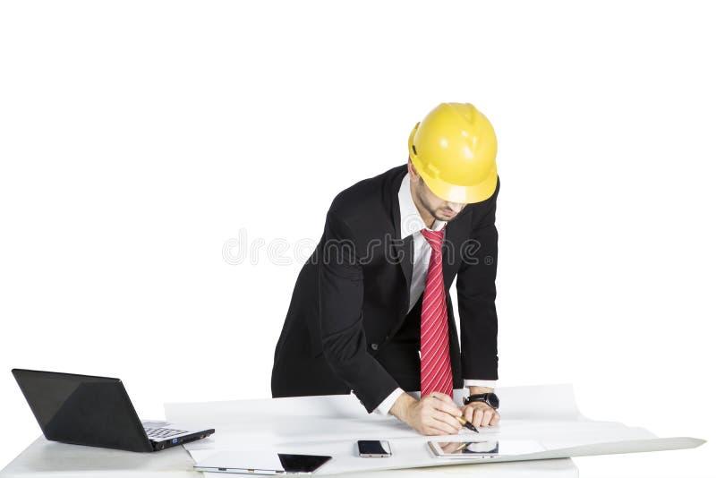 Supervisor da construção que trabalha com modelos foto de stock