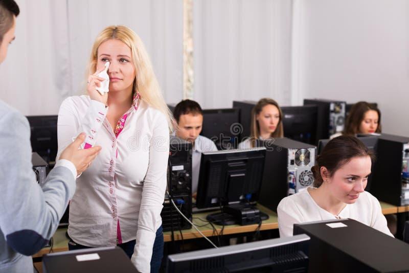 Supervisor scolding upset office worker. Furious supervisor scolding upset office worker stock photo