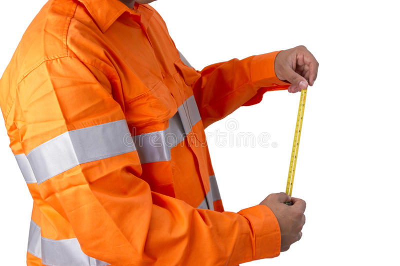 Supervisor with tape measure wearing high visibility shirt on a royalty free stock photo