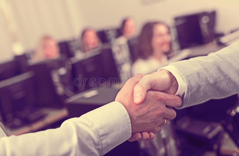 Supervisor thanking staff member stock photos
