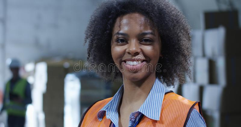 Supervisor in a warehouse. Medium shot of female supervisor in a warehouse royalty free stock photography