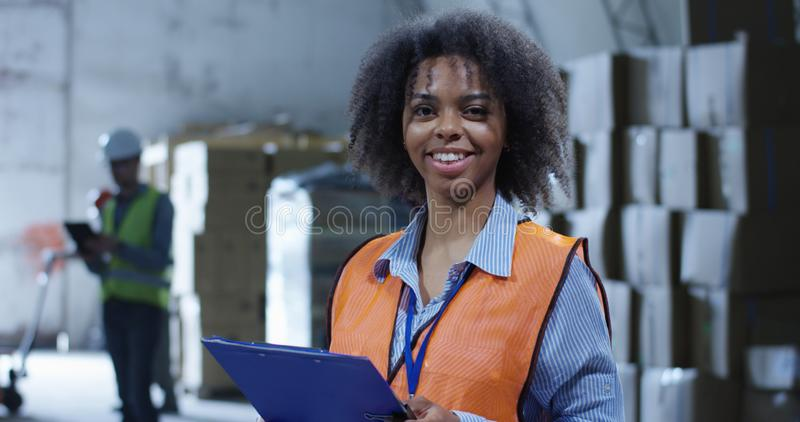 Supervisor in a warehouse. Medium shot of female supervisor in a warehouse stock photo